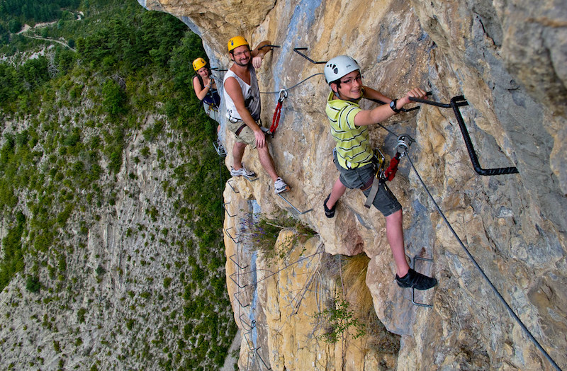 family climbing Via Ferrata